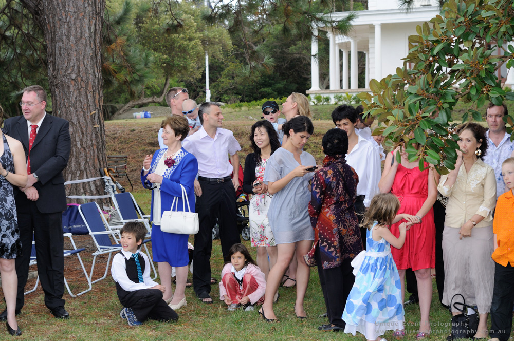 Guest mingle during the ceremony. Garden Wedding Photographer Sydney.