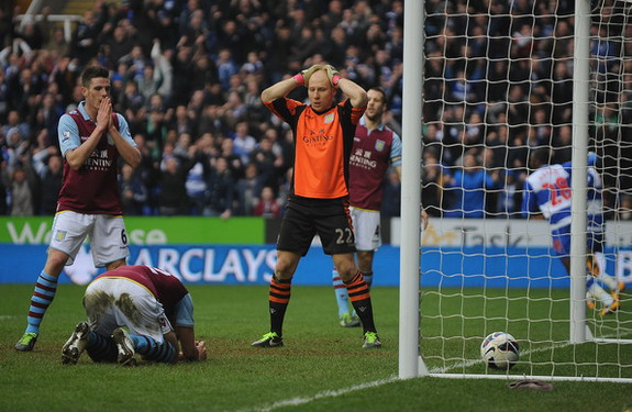 Brad Guzan and Ciaran Clark hold their heads after Nathan Baker scores an own goal
