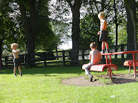 shirtless schoolchildren playing in the park