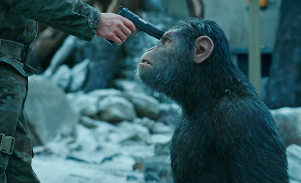 Caesar (voiced by Andy Serkis) is being held at gunpoint in WAR FOR THE PLANET OF THE APES (2017)