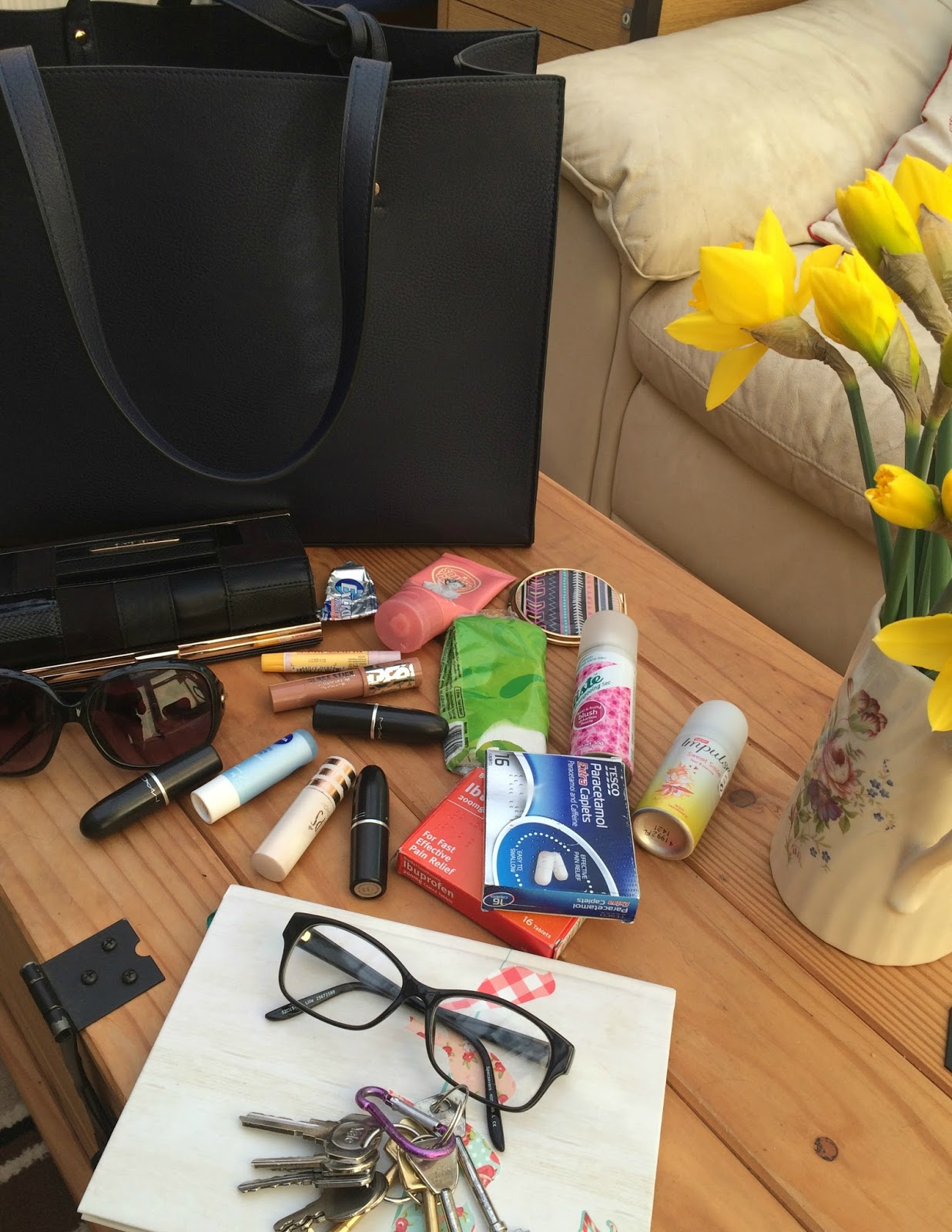 Items in my everyday handbag a navy tote from oasis, including Mac lipsticks, glasses and sunglasses