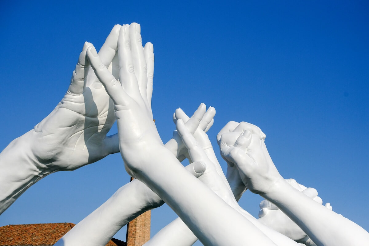 Monumental Installation Of Hands Creating A Bridge Of Unity In Venice