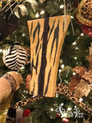 http://www.trendytree.com/raz-christmas-and-halloween-decor/raz-flat-glittered-black-and-gold-animal-print-present-ornament-set-of-2.html