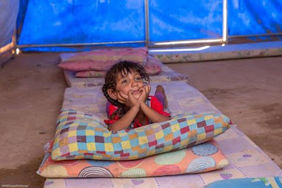Meet Shahad, 3, in her family's tent at a displacement camp near Qayarrah, Iraq
