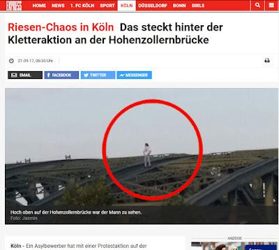 http://www.express.de/koeln/riesen-chaos-in-koeln-das-steckt-hinter-der-kletteraktion-an-der-hohenzollernbruecke-28446920?originalReferrer=