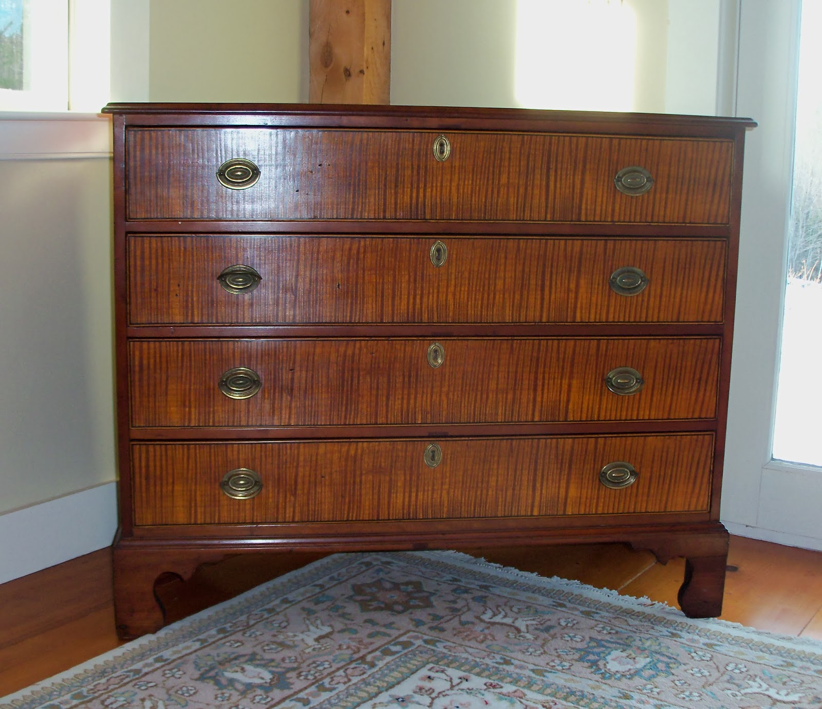antique cherry and tiger maple chest of drawers