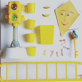 Flatlay of vintage dolls' house miniatures in yellow colours.