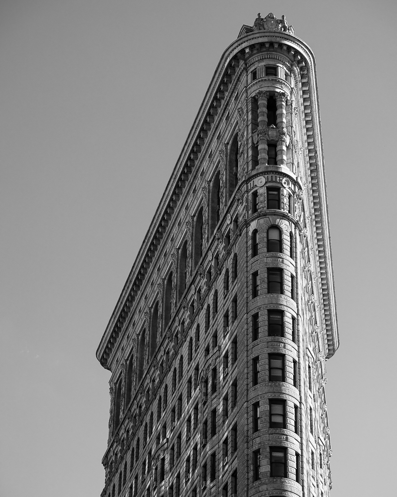 a photo of the top of the flatiron building in new york city in black and white