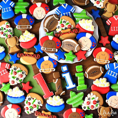 Football themed decorated sugar cookies - football players, pizza, trophy, jerseys.