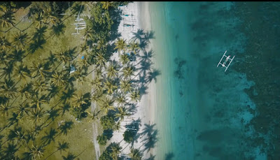 A royalty free of aerial drone shot of best beach to visit in indonesia - Nipah beach Lombok Island