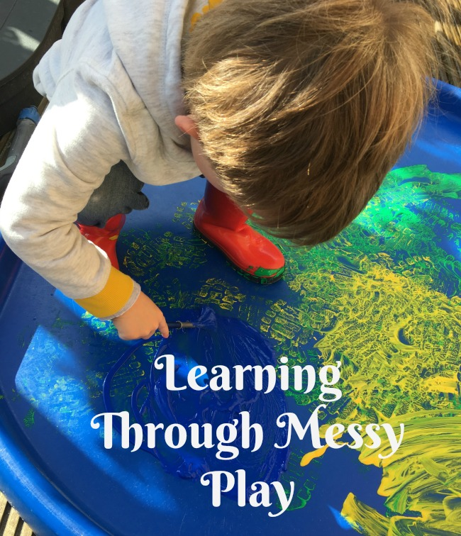 learning-through-messy-play-text-over-image-of-paint-and-toddler-on-Tuff-spot