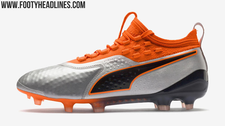 This picture shows the silver and orange next-gen Puma ONE 1 2018-19 boots. eeb4c1ebd