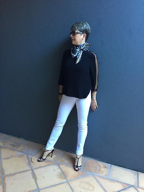 white denims, black blouse, stiletto shoes, vintage scarf