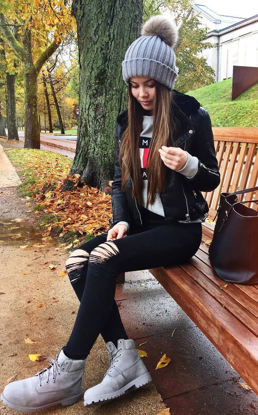 fall fashionable outfit / knit hat + biker jacket + ripped jeans + boots + sweatshirt