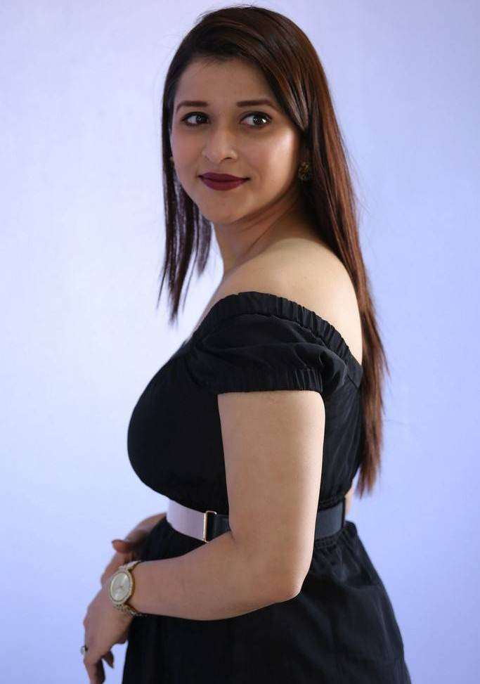 Beautiful Telugu Girl Mannara Chopra Long Hair In Mini Black Dress