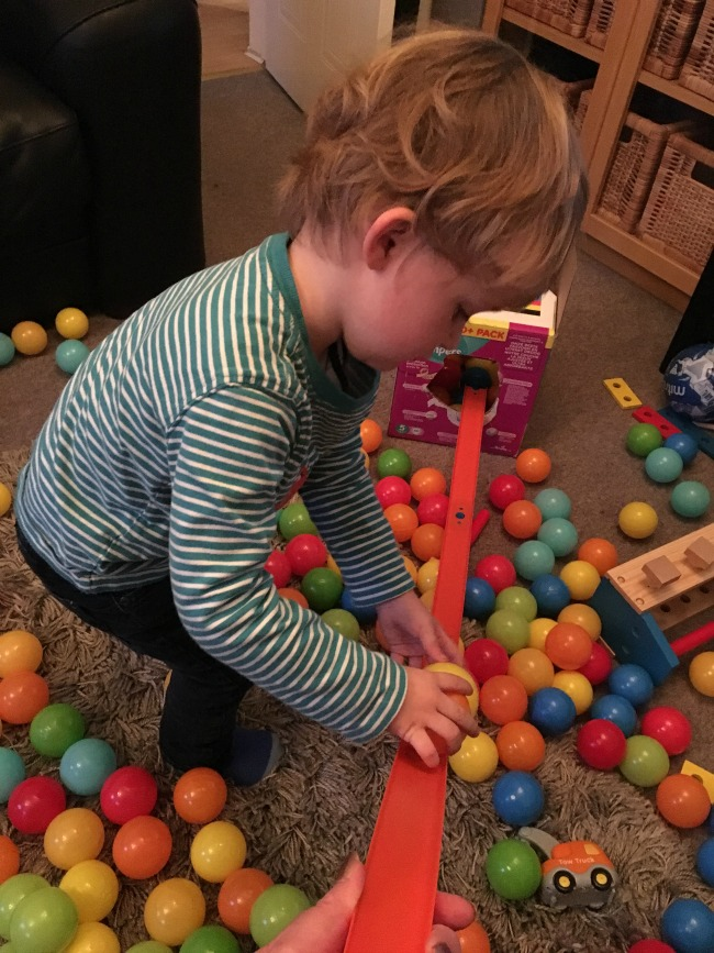 5-minute-games-treasure-chest-image-of-toddler-playing-with-plastic-balls