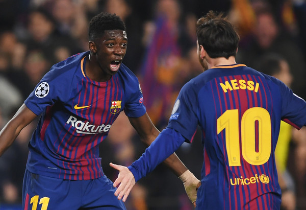 Barcelona Ousmane Dembele celebrates with Lionel Messi