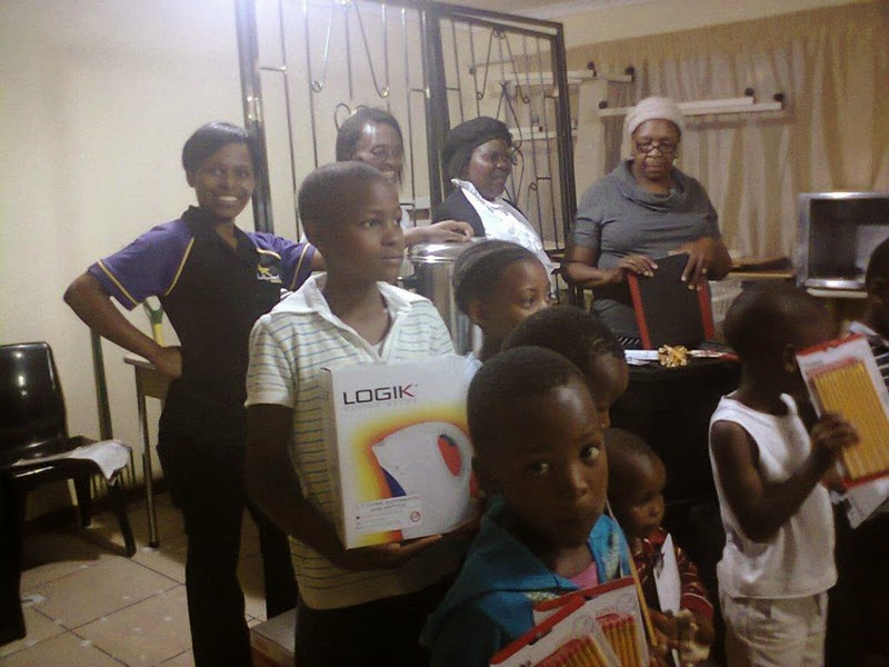 Hollywoodbets team with  the staff and children at Abasizikazi Home Based Care