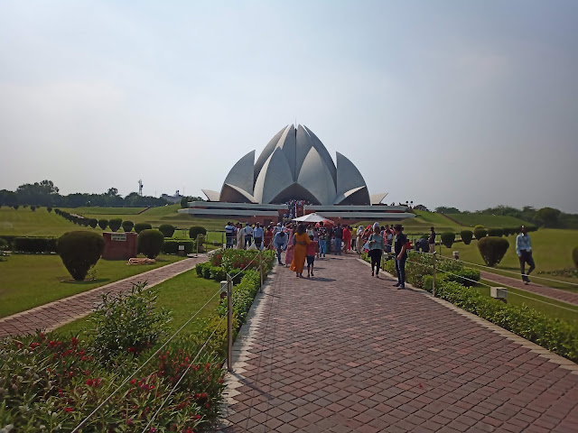 View of Lotus temple surrounded by gardens in Delhi