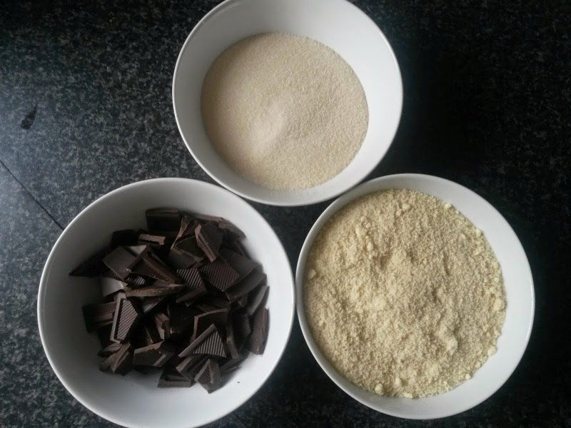 Ingredients for homemade chocolate, almond and orange cake