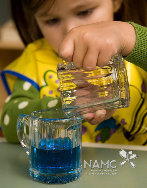 namc montessori functionality environment. child holding pitcher