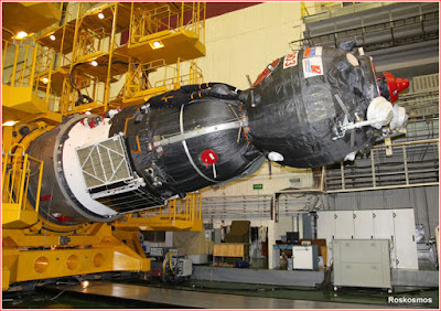 The Soyuz MS spacecraft is lowered into horizontal position prior to its integration with its payload fairing on June 30, 2016.