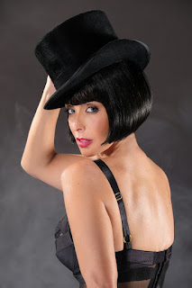 louise redknapp poses in black underwear and top hat for cabaret