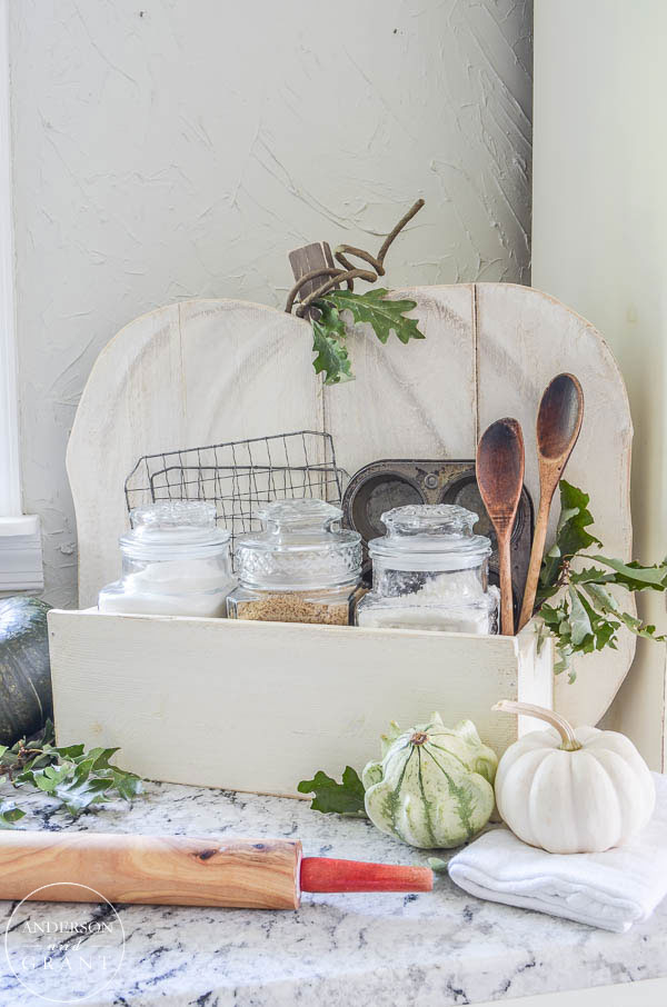 This Home Depot DIY Rustic Pumpkin Stand is perfect for holding your fall baking supplies.  See the tutorial at www.andersonandgrant.com