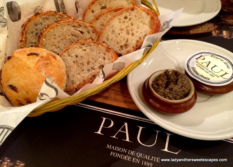 complimentary bread, olive paste and butter at Paul BurJuman