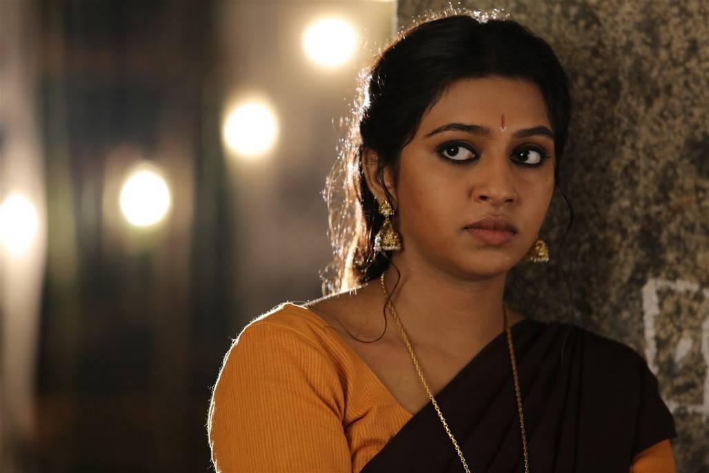 Glamours Tamil Girl Lakshmi Menon Photos In Maroon Lahenga Voni Half Sari