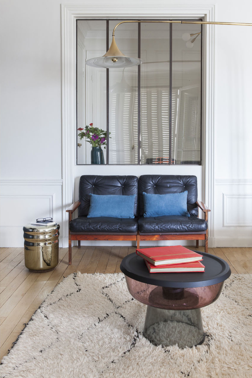 paris apartment with teal color, mid century modern furniture, couch, cartpet