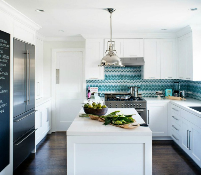 Beautiful coastal kitchen with silver fox light, modern touches, chevron backsplash