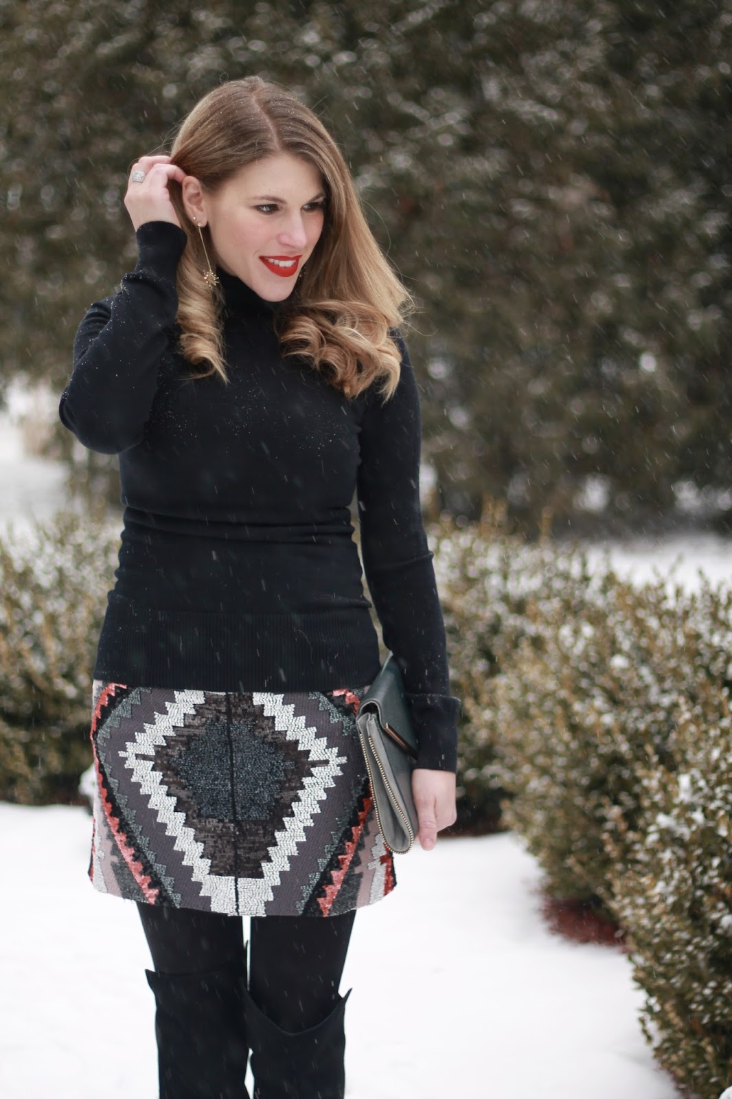 sequined skirt with black turtleneck and OTK boots