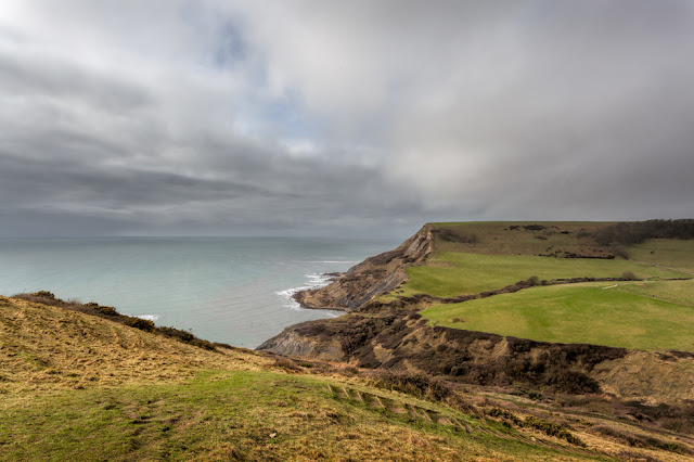 Jurassic coastline around Chapman's pool under a cloudy sky in Dorset