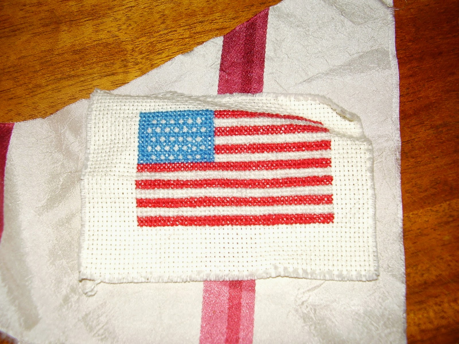 Cross stitched American flag with 32 stars.