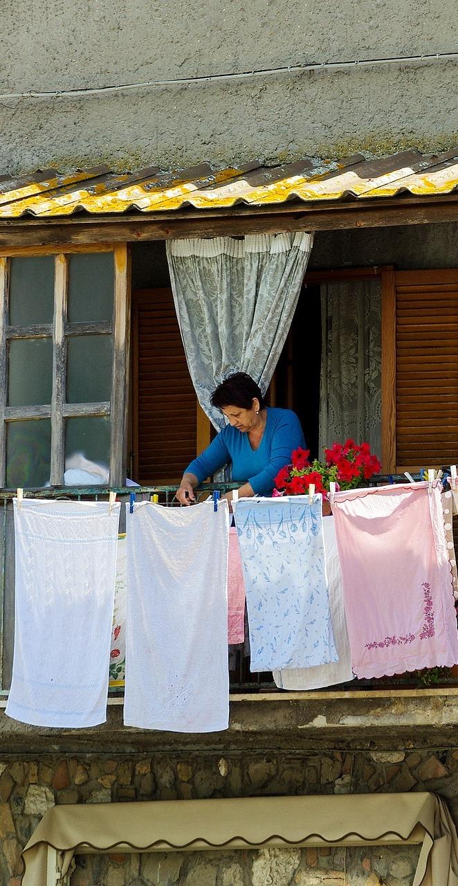 A woman hanging cloths.