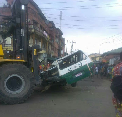 Driver Dies On The Spot As Truck Falls On Bus In Lagos (Photos)