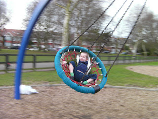 swinging on the hanging basket in the park