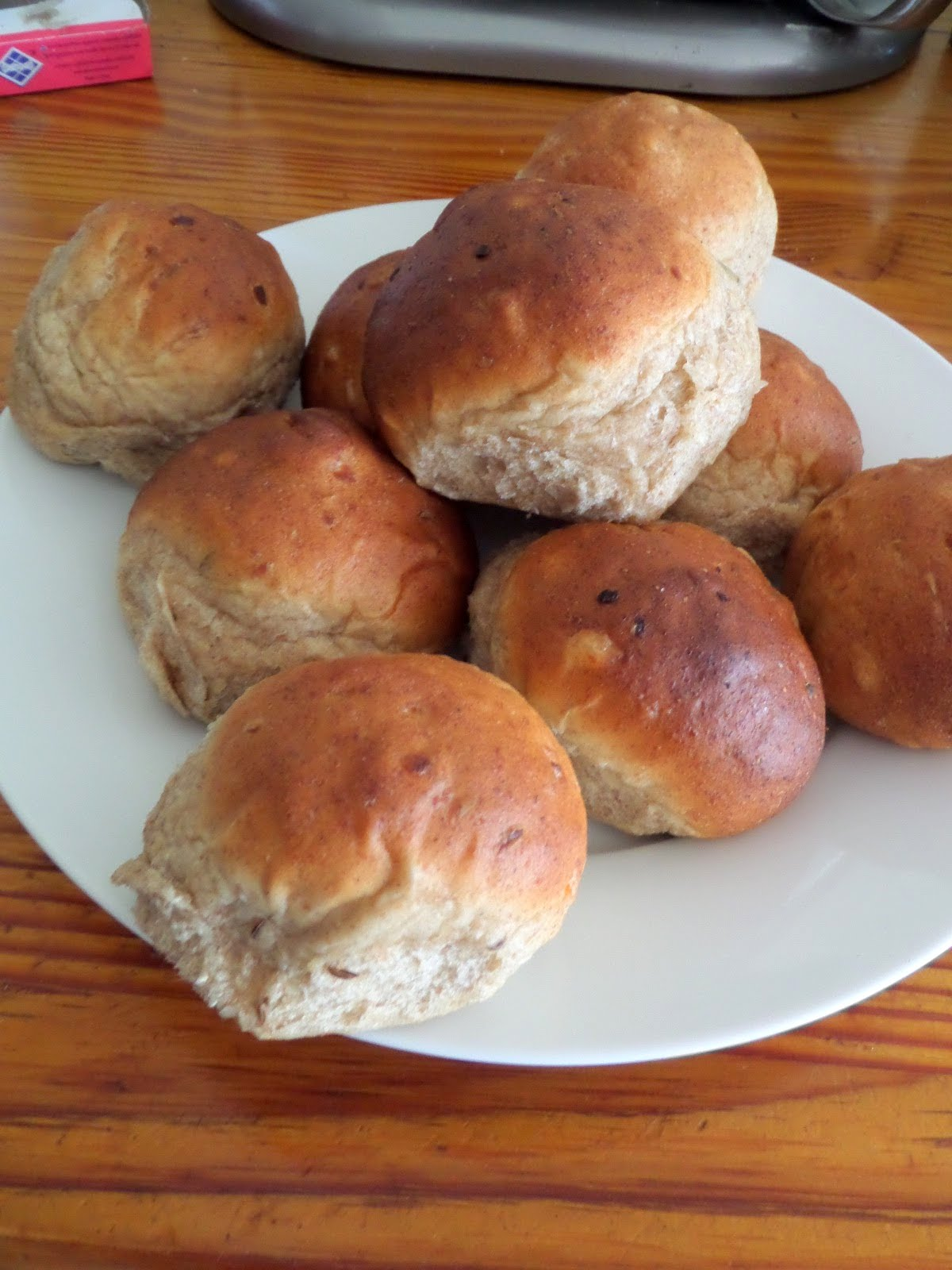 Rye Yeast Rolls:  Soft and fluffy yeast rolls made with rye flour, onions, and caraway seeds.