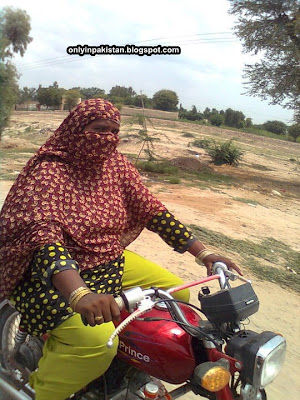 Funny Pakistani female on moterbike