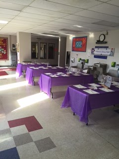 Four large tables with purple table clothes