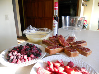 Preparing to assemble the mixed berry trifle.