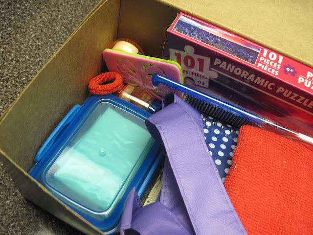 Packing an OCC shoebox by nesting items.