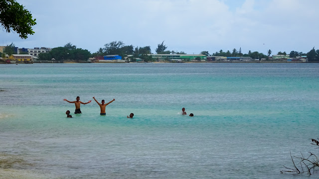 Kind locals taking a bath in the lagoon