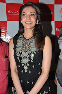 Kajal Aggarwal in lovely Black Sleeveless Anarlaki Dress in Hyderabad at Launch of Bahar Cafe at Madinaguda 032.JPG