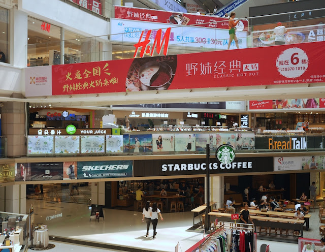 "Starbucks with ""Starbucks Coffee"" storefront sign at China Plaza in Guangzhou"