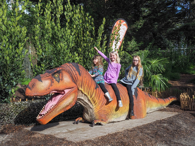 kids riding t-rex