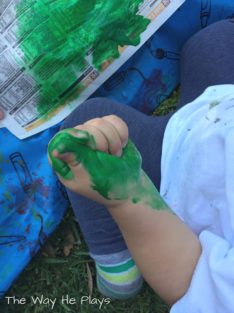 Little toddler hand covered in paint
