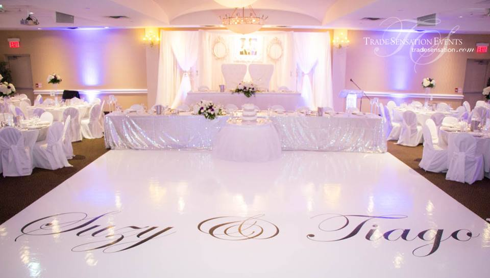 Bridal Party Head Table With Silver Sequin Table Linens And White Thulle  Skirt On Cake And Bride/groom Table.