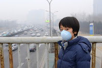 Face masked Chinese (Credit: Shutterstock) Click to Enlarge.